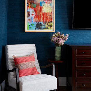 This is an example of an eclectic bedroom in Chicago with blue walls, dark hardwood floors and brown floor.