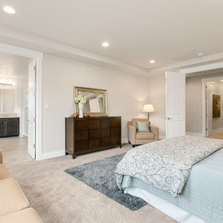 Inspiration for a large craftsman master carpeted bedroom remodel in Seattle with beige walls and no fireplace