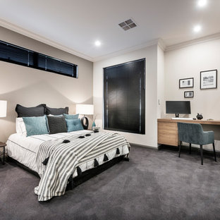 Photo of a contemporary bedroom in Perth with beige walls, carpet and grey floor.