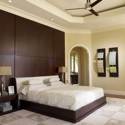 Bedroom - large contemporary master dark wood floor and brown floor bedroom idea in Tampa with beige walls and no fireplace