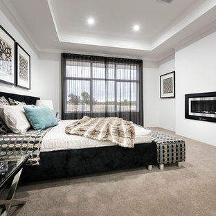 Mid-sized trendy master carpeted bedroom photo in Perth with white walls, a ribbon fireplace and a metal fireplace