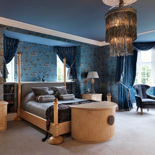 Example of a large eclectic guest carpeted bedroom design in Other with blue walls and no fireplace