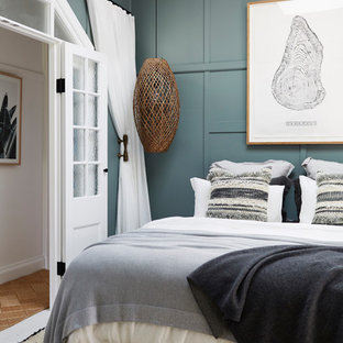Bedroom - mid-sized tropical master painted wood floor and white floor bedroom idea in Sydney with blue walls