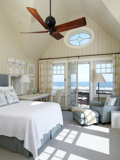 beach house bedroom. Inspiration for a beach style carpeted bedroom remodel in Charleston with  beige walls Beach House Bedroom Houzz