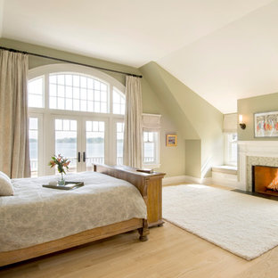 Bedroom - traditional light wood floor bedroom idea in Boston with beige walls and a standard fireplace