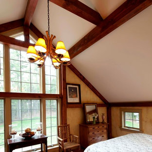 Inspiration for a large timeless master medium tone wood floor bedroom remodel in Manchester with beige walls