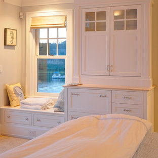 Photo of a large beach style master bedroom in Boston with blue walls, carpet and beige floor.