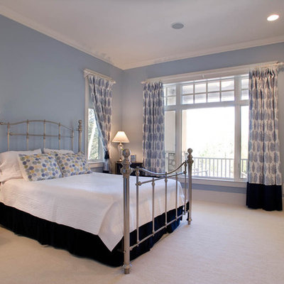 Large elegant master carpeted and blue floor bedroom photo in Milwaukee with blue walls and no fireplace