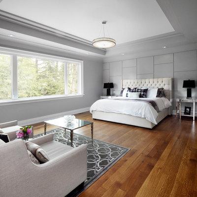 Trendy medium tone wood floor bedroom photo in Toronto with gray walls