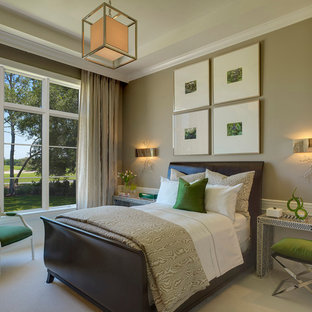 Inspiration for a transitional guest carpeted bedroom remodel in Miami with beige walls