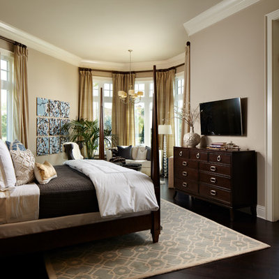 Inspiration for a large timeless master dark wood floor bedroom remodel in Tampa with brown walls and no fireplace