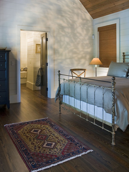 Inspiration For A Rustic Dark Wood Floor Bedroom Remodel In Atlanta With  White Walls
