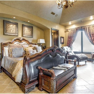 Large elegant master limestone floor and beige floor bedroom photo in Dallas with beige walls, a standard fireplace and a wood fireplace surround
