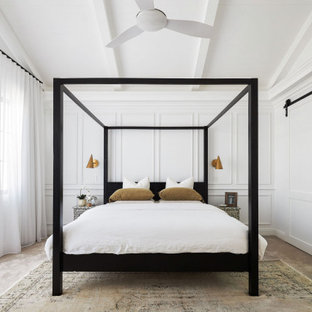 Design ideas for a country bedroom in Other with white walls, grey floor, vaulted and panelled walls.