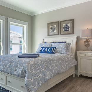 Small coastal guest vinyl floor bedroom photo in Miami with gray walls and no fireplace