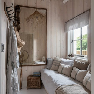 Design ideas for a small tropical guest bedroom in Cornwall with beige walls and grey floor.
