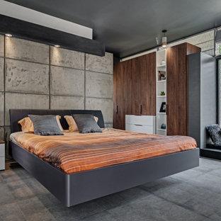Exempel på ett mycket stort modernt huvudsovrum, med grå väggar och grått golv