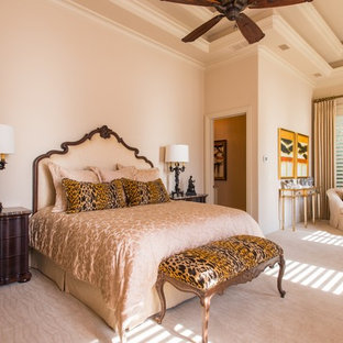 Inspiration for a large eclectic master carpeted bedroom remodel in Dallas with beige walls and no fireplace
