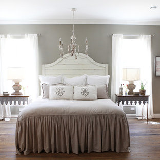 Medium sized romantic master bedroom in Austin with grey walls, medium hardwood flooring and no fireplace.