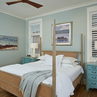 Large transitional master medium tone wood floor and brown floor bedroom photo in Grand Rapids with blue walls