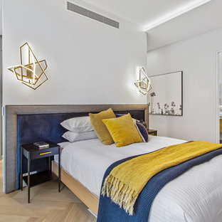 Design ideas for a contemporary bedroom in Melbourne with white walls, light hardwood floors and beige floor.