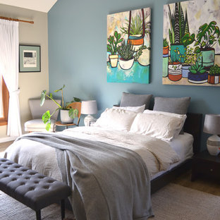 This is an example of a contemporary master bedroom in Other with blue walls and brown floor.