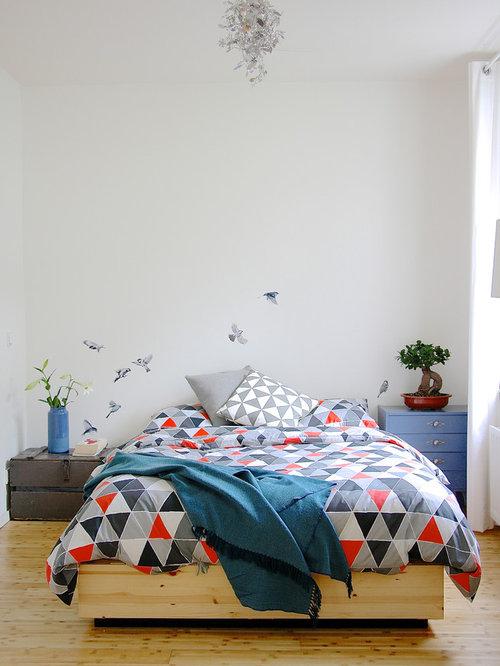 Bedroom - scandinavian light wood floor bedroom idea in Amsterdam with  white walls