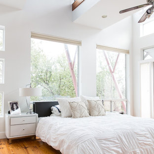 Inspiration for a country master bedroom in New Orleans with white walls and medium hardwood flooring.