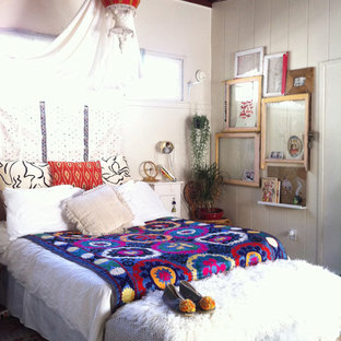 Inspiration for an eclectic bedroom in Los Angeles with white walls.