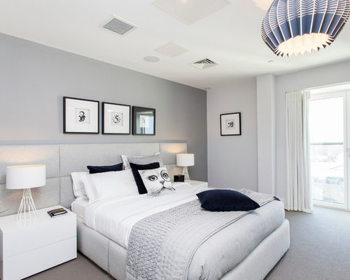 Design Ideas For A Contemporary Bedroom In London With Grey Walls And  Carpet.