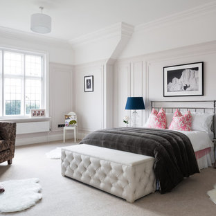 Transitional bedroom in Surrey with carpet.
