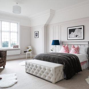 Classic bedroom in Surrey with carpet.