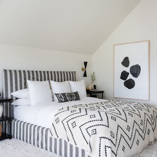 Inspiration for a transitional guest light wood floor bedroom remodel in Los Angeles with white walls and no fireplace