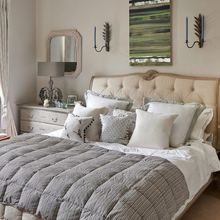 Inspiration for a shabby-chic style carpeted bedroom remodel in Wiltshire with beige walls and no fireplace