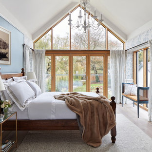 Inspiration for a traditional bedroom in Brisbane with blue walls, light hardwood floors and beige floor.