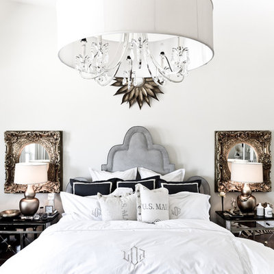 Inspiration for an eclectic master bedroom remodel in Dallas with white walls