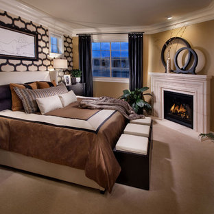 Tuscan bedroom photo in Denver with a corner fireplace