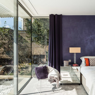 Inspiration for a contemporary bedroom in London with purple walls and carpet.