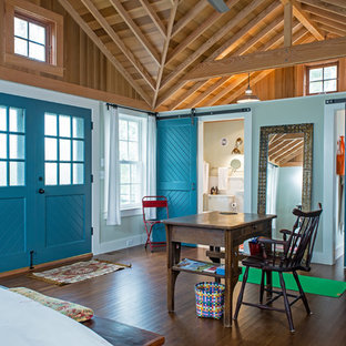 Design ideas for a large country master bedroom in Boston with blue walls, dark hardwood floors and brown floor.