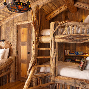 Inspiration for a rustic guest bedroom remodel in Other