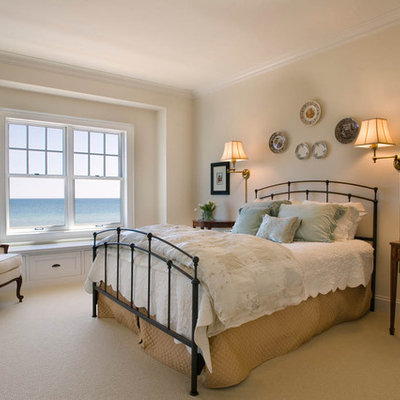 Bedroom - large coastal master carpeted and beige floor bedroom idea in Milwaukee with beige walls and no fireplace