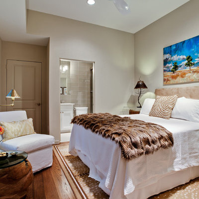 Mid-sized elegant guest medium tone wood floor bedroom photo in Dallas with no fireplace and gray walls