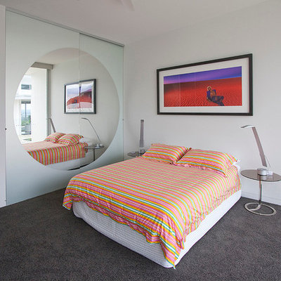 Trendy bedroom photo in Los Angeles with white walls