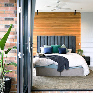 Inspiration for a contemporary master bedroom in Brisbane with concrete floors and grey floor.