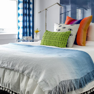 Inspiration for a small contemporary guest bedroom remodel in New York with white walls and no fireplace