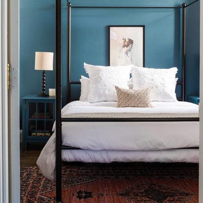 Bedroom - transitional dark wood floor and brown floor bedroom idea in Salt Lake City with blue walls