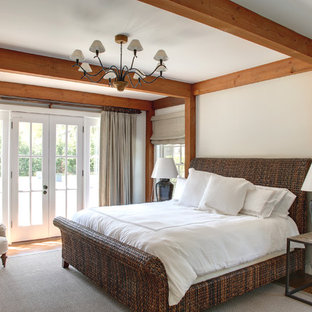 Bedroom - large traditional master medium tone wood floor and brown floor bedroom idea in Manchester with white walls and no fireplace