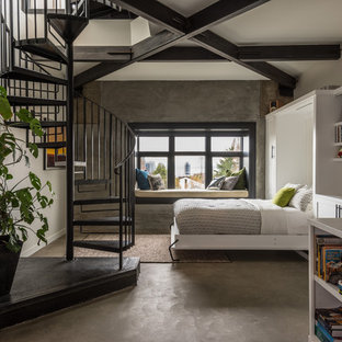 Design ideas for a small contemporary guest bedroom in Seattle with white walls, concrete floors and brown floor.