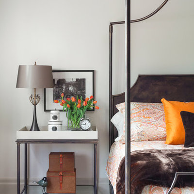 Inspiration for a timeless master dark wood floor bedroom remodel in Toronto with white walls