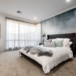 Photo of a mid-sized contemporary master bedroom in Perth with white walls, carpet and grey floor.